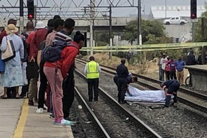 Photo of covered body on railway tracks