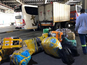 Photo of bags of goods at a bus station