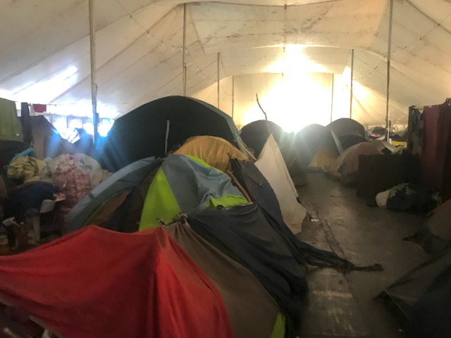 Photo of a tent city inside a marquee