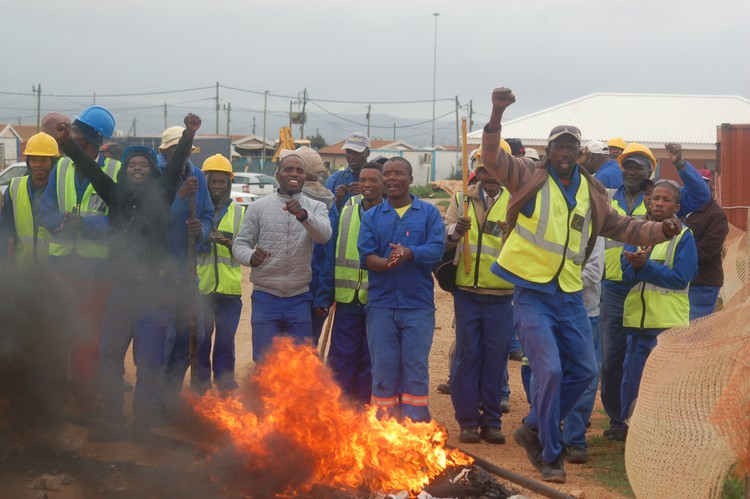 Photo of workers protesting