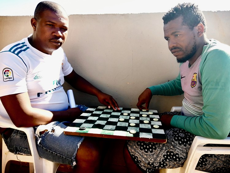 Photo of two people playing draughts