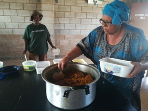 Photo of woman dishing out food