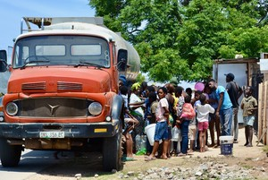 Photo of people at a water tanker