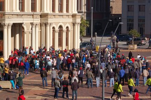 Photo of striking workers in front of city hall