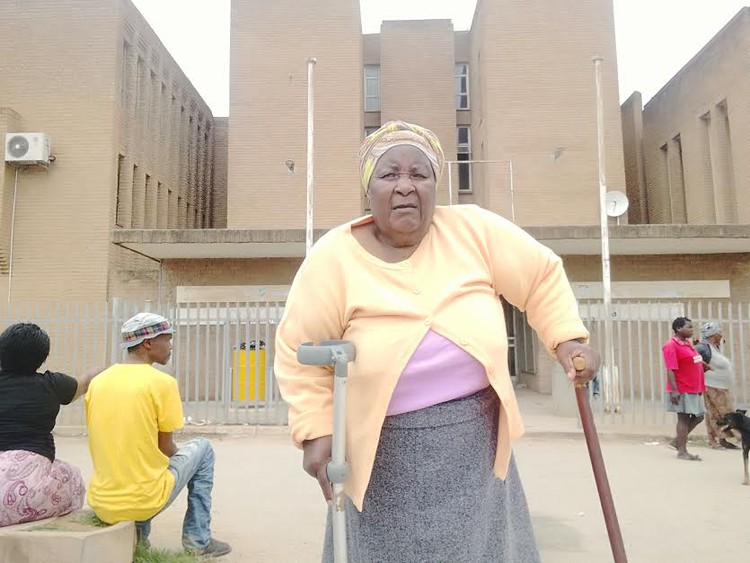 Photo of elderly woman on crutches