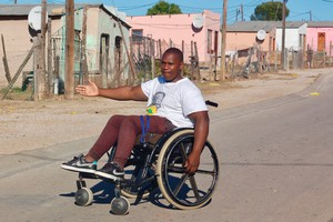 Photo of a man in a wheelchair