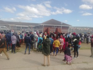 Photo of patients outside the clinic gates