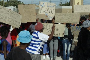 Photo of Khayelitsha residents protesting outside a school