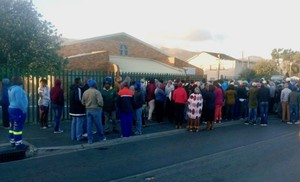 Photo of people outside a community hall