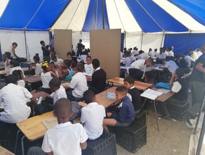 Photo of learners in the tent
