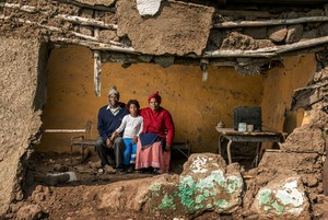 Photo of family in broken hut
