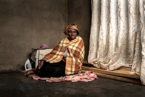 Photo of widow of Makatieho Selibo, a gold miner who died in 2013.