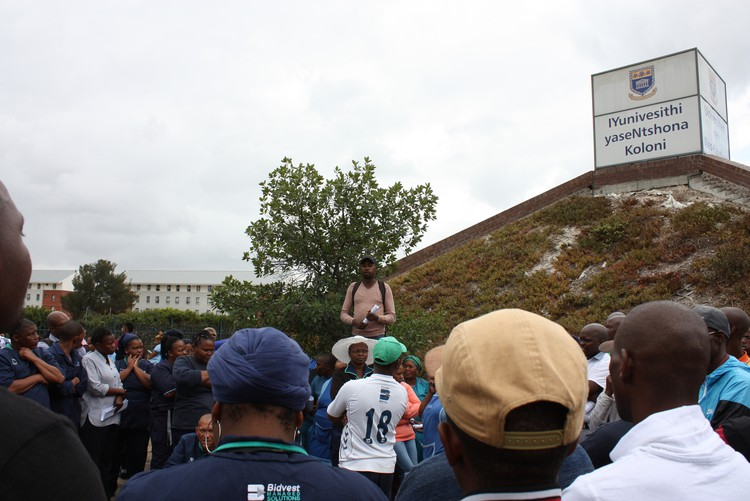 Photo of workers standing outside UWC