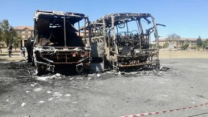 Photo of two burnt out busses