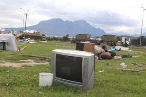 Photo of TV in demolished shack