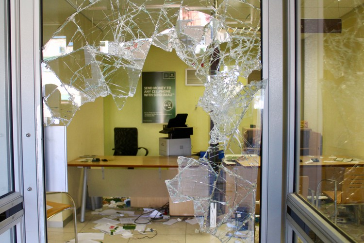 Photo of a smashed shop window