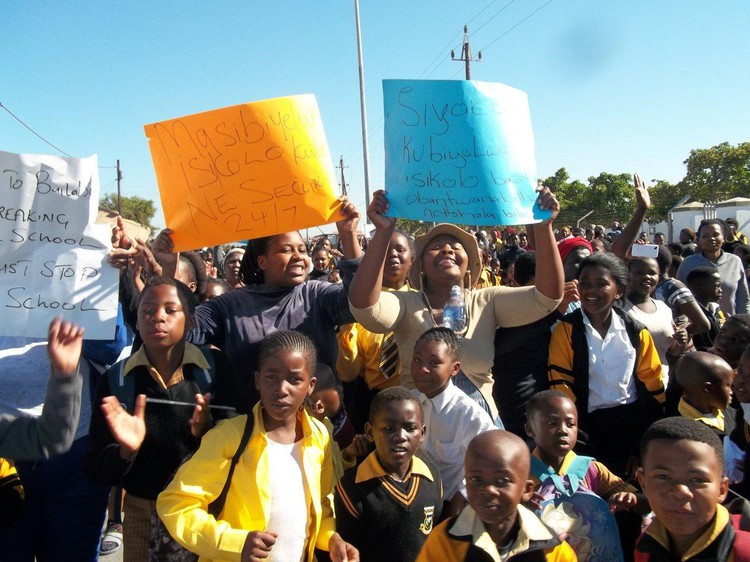 Photo of parents and learners marching