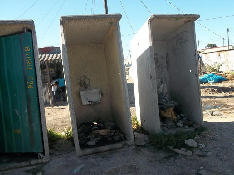 Photo of broken toilets full of rubble