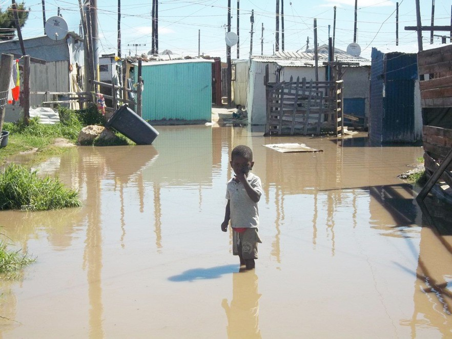 Photo of child in flooded area