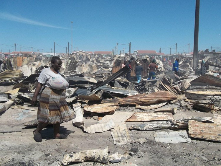 Over a thousand people are left homeless and one person was killed after a fire ravages the SST Section in Khayelitsha. - Vincent Lali