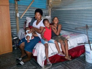 Photo of a family in a shack