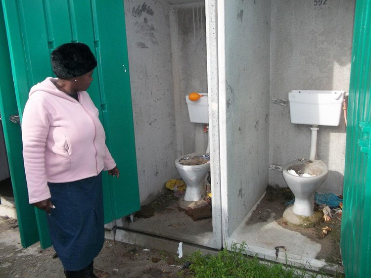 Photo of blocked and overflowing toilets.