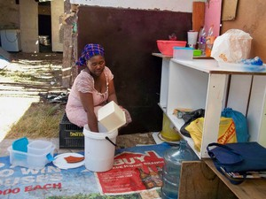 Photo of a woman washing up