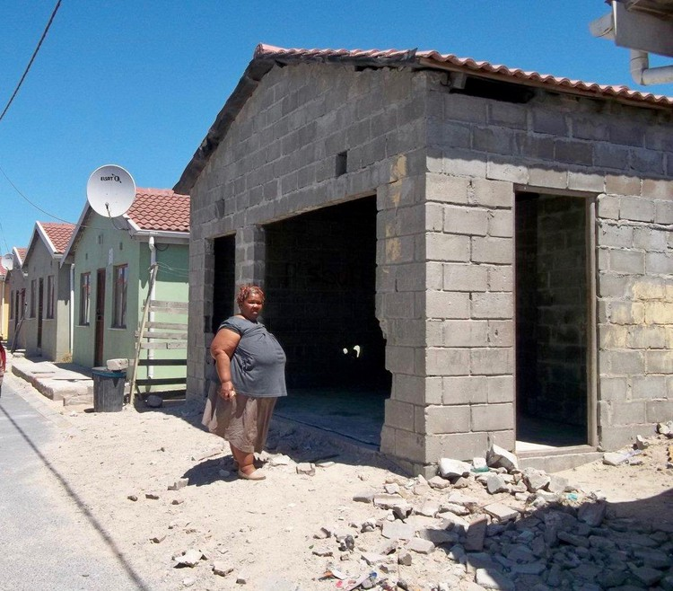 Photo of a house with bare walls