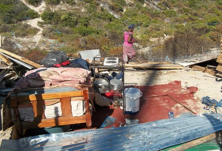 Photo of demolished shacks
