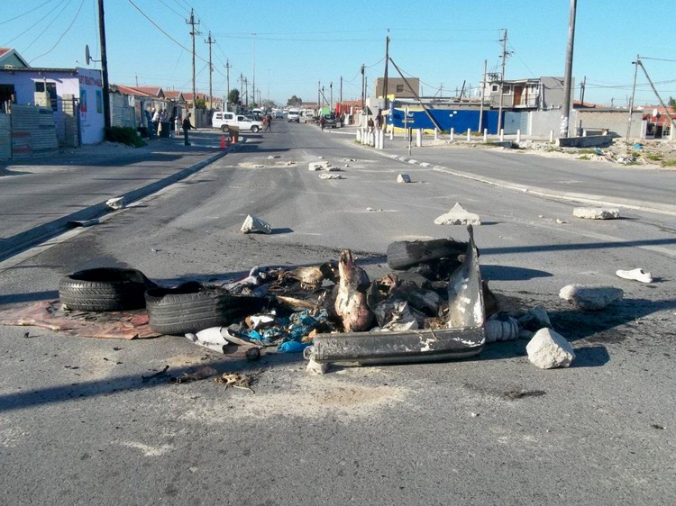 Fed up residents from Sondela informal settlement in Mfuleni, Cape Town, protested over the absence of electrification by blocking roads with debris and burning tyres on Wednesday. Photo: Vincent Lali
