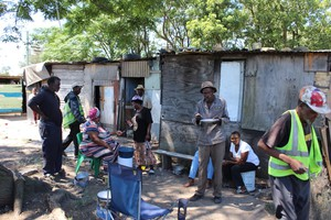 Photo of shacks and people