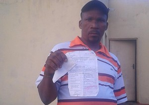 Photo of man holding Home Affairs document
