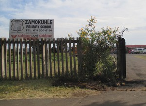 Photo of a school gate and sign
