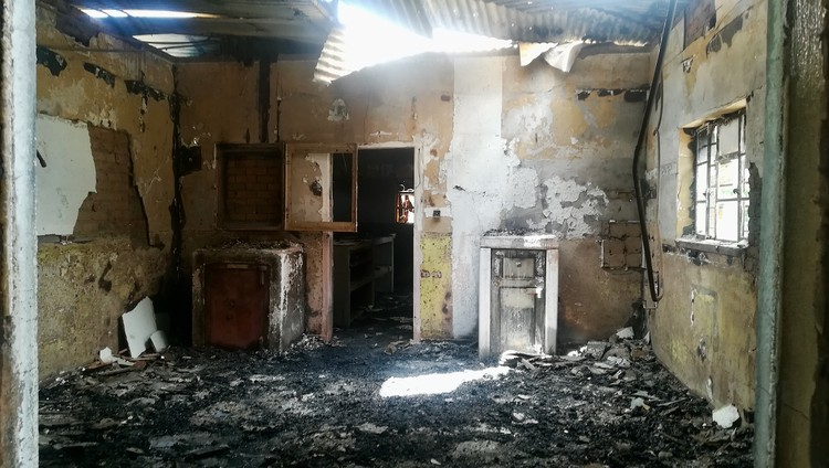 Photo of a room gutted by fire