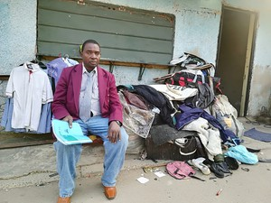 Photo of man with his belongings outside