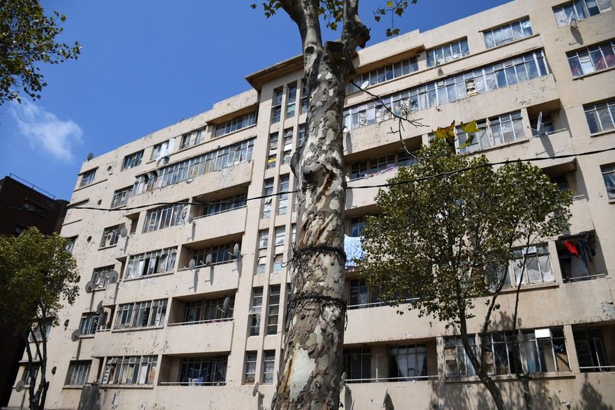 Hillbrow residents move nearly 500 tons of trash from their derelict building