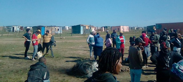 Photo of people and shacks