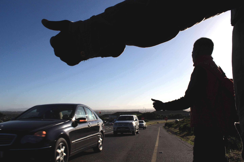 Photo of students hitchhiking on Ou Kaapse Weg