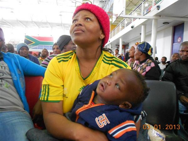 Mavis Mikani and her infant. Photo by Faizel Slamang.
