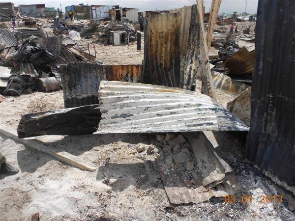 Ruins of Ntombi's kitchen. Photo by Faizel Slamang.