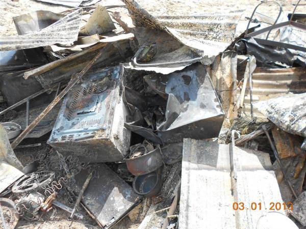 Ruins of Ntombi's microwave and fridge. Photo by Faizel Slamang.