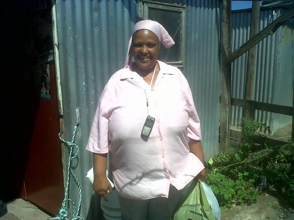 Maureen outside her home in Blikkiesdorp. Photo by Gabby Kelly.