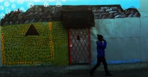 Table Mountain painted onto the facade of a shack on Main Road Mfuleni. Photo by Masixole Feni.
