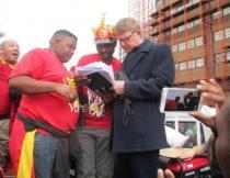 Collin Booysen of SEIFSA accepts a memorandum from Vuyo Lufefe and Thabang Tsidoli of NUMSA.