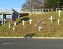 At Woolsack Drive crosses have been erected to commemorate the Marikana massacre. Photo by Daneel Knoetze.