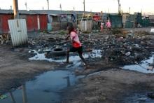Bhekela is a patchwork of shacks and large puddles. Photo by Anathi Vutula.