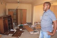 Mzoli Matutu looks at damage caused by vandals to the Mfuleni sports complex. Photo by Masixole Feni.