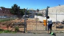 Rachel Harvey locks up the garden on Roeland Street, Cape Town. Photo by Bernard Chiguvare.
