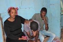 Neighbour Noxolo Mafilika and Sivuyile Sibhozo holding Sivuyile's 15-year-old brother. Photo by Nombulelo Damba.