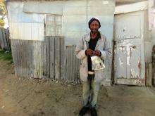 Zandisile Khobeni outside his one-room shack. Picture by Nombulelo Damba-Hendrik.